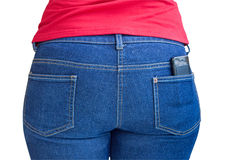 Cellphone sticking out of a jeans pocket Stock Images