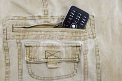 Cellphone stuffed in khaki jeans Royalty Free Stock Photography