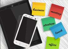 Cellphone and tablet with reminders sticker Royalty Free Stock Photos