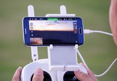 (UAV) Drone Operation & Cellphone Technology Royalty Free Stock Photos