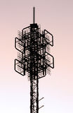 Cellphone tower structure. Silhouette view of a cellphone/communications tower structure Royalty Free Stock Photo