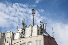 Cellphone transmitter on the top of the building.  Royalty Free Stock Photos