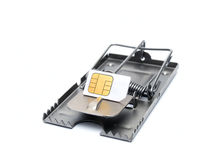 Cellphone trap. SIM card on the mousetrap isolated on a white background Stock Image