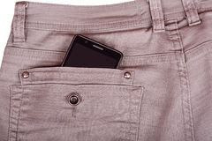 Cellphone in trousers back pocket Royalty Free Stock Image