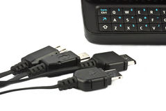 Cellphone usb charging plugs with keyboard mobile Stock Photos