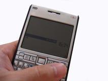 Cellphone van de holding Stock Afbeeldingen