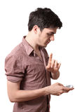 Cellphone van de jonge mensenholding Stock Foto