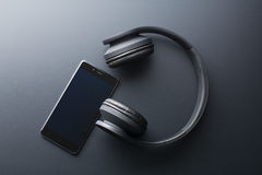 Cellphone and wireless headphones Stock Image