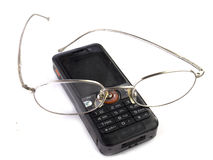Cellphone With Eyeglasses Stock Images