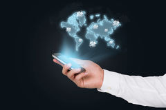 Cellphone with world map Stock Images