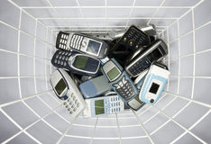 Cellphones. In a paper basket Royalty Free Stock Image