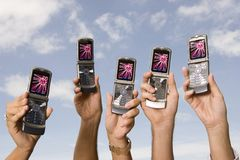 Cellphones in the air Stock Photo