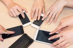 Cellphones on desk Stock Photos