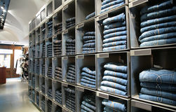 Cells with jeans in shop Stock Image