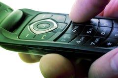 Celltelefon i en hand Royaltyfria Bilder