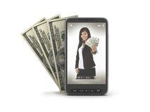 Celltelefon och dollarbills Arkivbilder