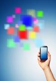 Celltelefon och en futuristic digital återgivning Arkivfoto
