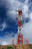 Cellular antenna. New cellular antenna in the mountains. Clouds and blue sky are on the background Stock Photo