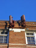 Cellular antenna painted to look like red bricks mounted to the Royalty Free Stock Photo