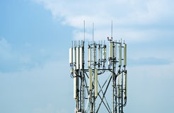 Cellular antenna tower. Over blue sky Stock Photo
