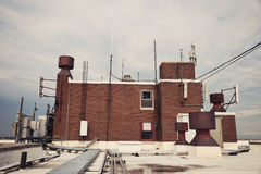 Cellular antennas on the roof Stock Photography