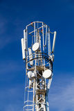 Cellular antennas on the top of the mast, close-up on a backgrou Stock Photos