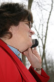 Cellular chat. A business lady chatting on her cell phone stock photo