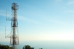 Cellular communication tower in blue sky background Royalty Free Stock Photo
