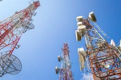 Cellular communication towers on blue sky. Background Stock Photo