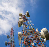 Cellular communication towers on blue sky. Background Royalty Free Stock Photos