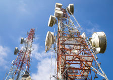 Cellular communication towers on blue sky Stock Images