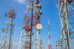 Cellular communication towers on blue sky. Background Royalty Free Stock Images
