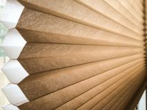 Cellular Honeycomb Shade Blinds Window Treatment Covering Sandy Brown. Fiber paper fabric material window shades covering an interior window with cellular Royalty Free Stock Photography