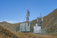 Cellular, microwave and telecom communications antennas in the top of the mountains Stock Photos