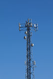 Cellular mobile radio transmission pole tower. On the blue sky stock photography