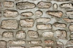 Cellular Modern Concrete Wall With Stones Background Stock Image