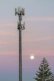 Cellular network base station. Cellular radio tower at dusk Stock Photo