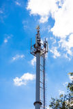Cellular network mobile telephony radio tower. Against blue sky Stock Image