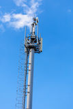 Cellular network mobile telephony radio tower. Against blue sky Stock Images