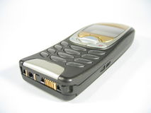 Cellular Phone. A grey and golden colored cellular phone Stock Photos