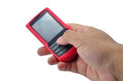 Cellular Phone. One's hand holding red cellular phone Stock Images