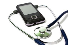 Cellular Phone And Stethoscope Stock Photo