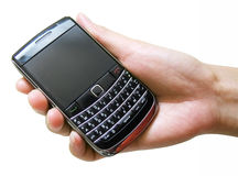 Cellular phone in hand. Cellular phone in female hand Royalty Free Stock Image