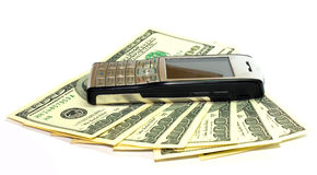 Cellular phone on hundreds of dollar Stock Images