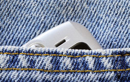 Cellular phone in the jeans pocket. Concept of communication and style Stock Photography