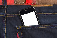 Cellular phone in jeans pocket Stock Images