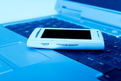 Cellular Phone on Laptop Stock Photo