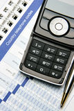 Cellular phone on organizer Stock Image
