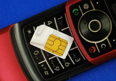 Cellular phone with a SIM card Stock Photos