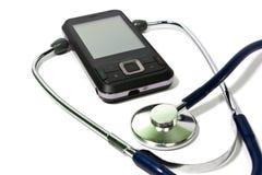 Cellular phone and stethoscope Stock Photo